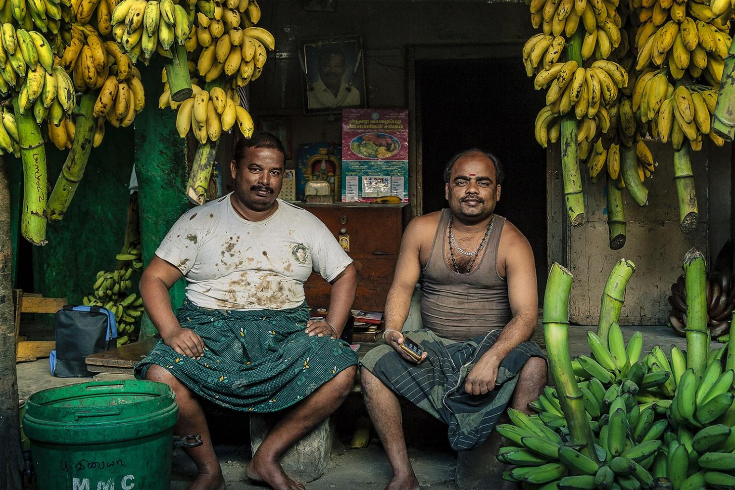 Banana men Madurai fruit market, Tamil Nadu 2012 digital photography